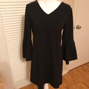Black sheath with pleated bell sleeves